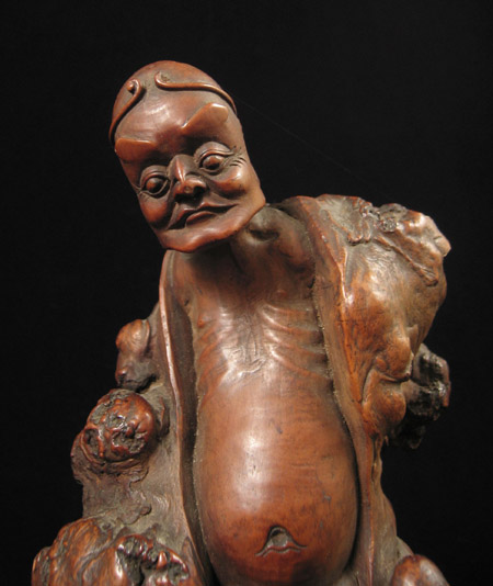 Asian Tribal Art - Male figure, China, detail