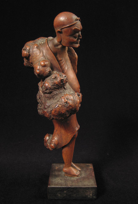 Asian Tribal Art - Male figure, China, left
